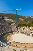 Ancient amphitheater and construction crane in Ephesus Turkey