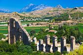 Aqueduct at Aspendos in Antalya, Turkey - archaeology background