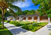 Hotel at tropical beach - vacation background