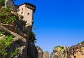 Meteora monastery and lifting cage in Greece - travel background