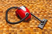 Vacuum cleaner on carpet - technology housework