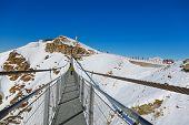 Suspension bridge at mountains ski resort Bad Gastein Austria