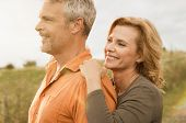 Happy smiling mature couple looking together at the horizon, outdoor