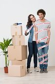 Smiling Woman Near Stack Of Boxes Wrapping Man With Sellotape