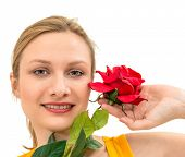 smiling woman with red rose isolated on white background