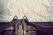Vintage typewriter and crumpled paper. Focus on ribbon.