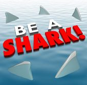 Be a Shark words in 3d letters on water with fins around it to illustrate fierce, aggressive, competitive spirit to win in business or life