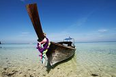 Adaman sea and wooden boat in Thailand. Tourism background with sea beach