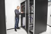 IT consultant building network rack in datacenter