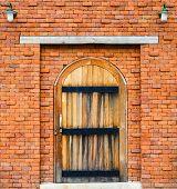 Wooden Door On Red Brick Wall Background