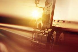 stock photo of trucks  - Semi Truck In Motion - JPG