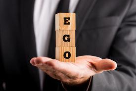 stock photo of pompous  - Businessman holding wooden alphabet blocks reading  - JPG