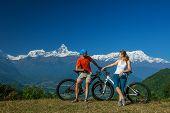 foto of biker  - Biker family in Himalaya mountains Anapurna region - JPG