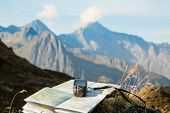 pic of gps  - GPS navigator and map on Alps mountain background - JPG