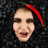 pic of licorice  - Beautiful woman face with licorice and chili frame - JPG