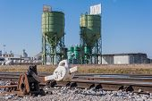 picture of silos  - Exchange railway manual with the background industrial silos - JPG