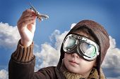 stock photo of bomber jacket  - Boy dressed up in pilot - JPG