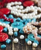 pic of beads  - Different Colorful Beads on wooden background - JPG