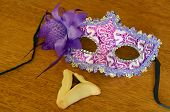 stock photo of purim  - Hamantaschen cookie and Purim jewish holiday carnival mask - JPG
