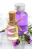 foto of lavender plant  - Aromatherapy spa background with a sprig of fragrant lavender with essential oil and plant extracts with copyspace - JPG