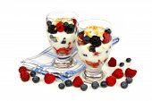 stock photo of berries  - Healthy mixed berry granola and yogurt parfaits on white background - JPG