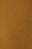 stock photo of knitting  - close up of a rust colored knitted background pattern, knitted right, detail, full frame, vertical ** Note: Visible grain at 100%, best at smaller sizes - JPG