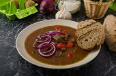 stock photo of red hot chilli peppers  - Original Czech beef goulash red onion hot chilli peppers in and bio healthy wholemeal bread - JPG