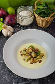pic of bacon  - Spinach gnocchi with parmesan sauce topped with bacon clean serving ingredients in background - JPG