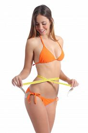 image of measurement  - Beautiful girl measuring her waist with a tape measure isolated on a white background - JPG