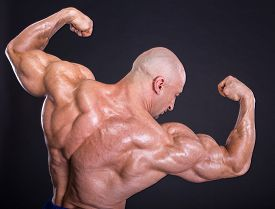 image of shoulder muscle  - Bodybuilder is posing showing his muscles - JPG