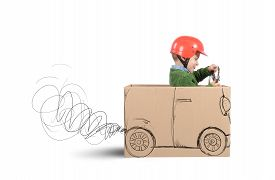 picture of sketche  - Creative baby plays with his cardboard car - JPG