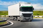 stock photo of delivery-truck  - White truck on the road blurred motion - JPG