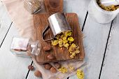 image of roughage  - Dried herbs with nutmeg on table close up - JPG