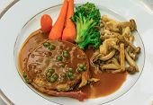 picture of hamburger-steak  - Filet Mignon steak with gravy sauce and carrot broccoli mushroom side - JPG