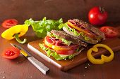 stock photo of tomato sandwich  - healthy sandwich with salami tomato pepper and lettuce - JPG