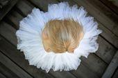 stock photo of tutu  - Close portrait of a cute ballerina in white tutu and blue bathing suit - JPG