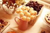 stock photo of cake pop  - Capture of White cake pops on a table - JPG