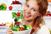 foto of refrigerator  - happy woman eats healthy food vegetable vegetarian salad about refrigerator - JPG