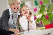 pic of grandma  - Happy grandma  and little girl looking at surprise  - JPG