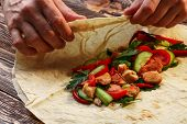 picture of shawarma  - Wrapping traditional shawarma wrap with chicken and vegetables - JPG