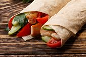 stock photo of shawarma  - Traditional shawarma wrap with chicken and vegetables - JPG