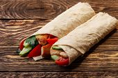 picture of shawarma  - Traditional shawarma wrap with chicken and vegetables - JPG