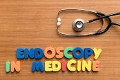 stock photo of endoscopy  - endoscopy in medicine colorful medical word and stethoscope on the wooden background - JPG