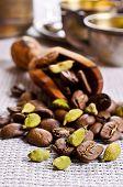 stock photo of cardamom  - Coffee beans and cardamom on burlap - JPG