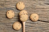 image of chocolate spoon  - chocolate chip cookie in spoon on wooden table - JPG