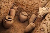 picture of empty tomb  - Old crocks stands in stone cellar interior - JPG