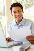 picture of filipino  - Filipino man working at home - JPG
