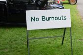 picture of street-rod  - No burnouts sign at a motor racing event - JPG