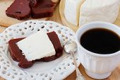 picture of juliet  - Brazilian dessert Romeo and Juliet goiabada and Minas cheese with cup of coffee on wooden table - JPG