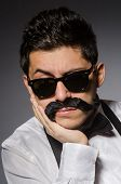stock photo of moustache  - Young man with false moustache isolated on gray - JPG